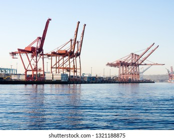 Seattle, WA, USA - April 1, 2016: Cargo cranes at the port of Seattle at sunset