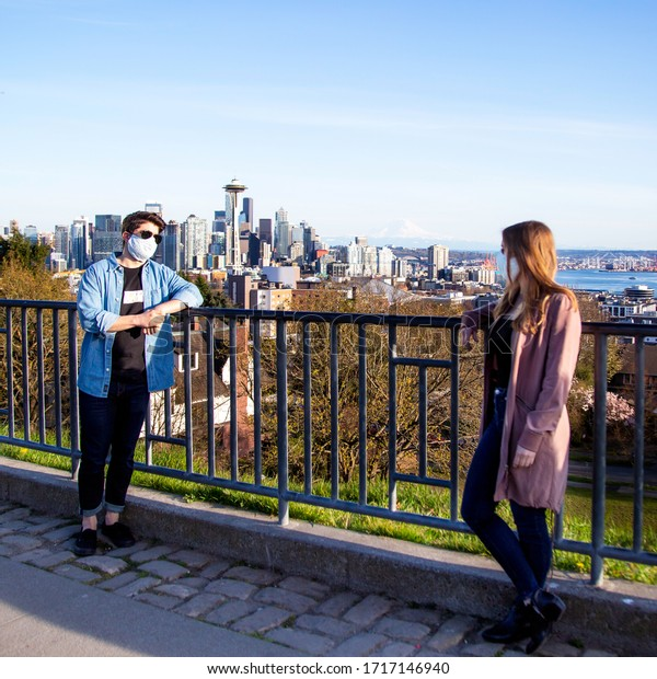Seattle, WA / USA - April 6 2020: An encounter maintaining a safe distance, social distancing, in public spaces, Kerry Park, cloth cotton fabric facemasks by SwaddleDesigns COVID-19 pandemic