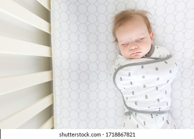 Seattle, WA / USA - Circa 2019: Safe Sleep Environment for Baby in Cotton Omni Swaddle Sack by SwaddleDesigns