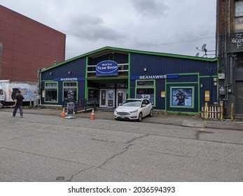 Seattle, WA USA - circa May 2021: Street view of the exterior of a Seattle Team Shop across from Lumen Field Stadium downtown.