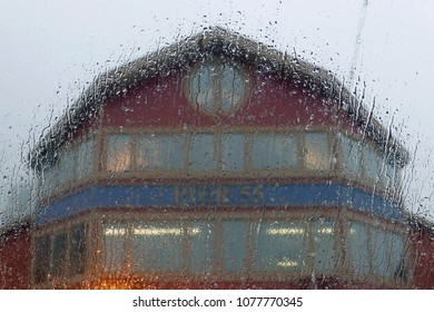 Seattle, WA, USA - December 29, 2017: Pier 55 seen through a window with raindrops