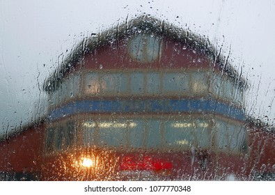 Seattle, WA, USA - December 29, 2017: Pier 55 seen through a window with raindrops
