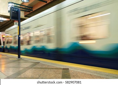 Seattle, WA, USA Feb 17, 2017: Motion blur of Sound Transit Link light rail train entering station in Seattle Transit tunnel