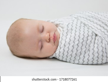 Seattle, WA / USA - February 2018: Safe Sleep Environment for Baby in Cotton Muslin Mini ZigZag Swaddle by SwaddleDesigns