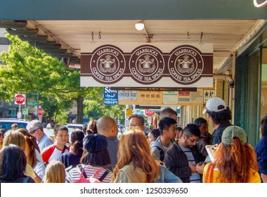 SEATTLE, WA, USA - JUNE 2018: People queuing outside the original branch of Starbucks in Pike Place, Seattle.