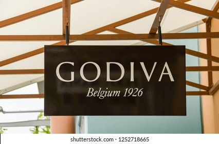 SEATTLE, WA, USA - JUNE 2018: Close up view of the sign outside the Godiva store at the Premium Outlets shopping mall near Seattle. The store sells products made with Belgian chocolate.