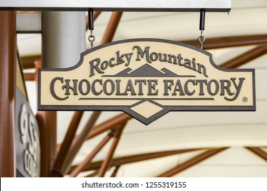 SEATTLE, WA, USA - JUNE 2018: Close up view of a sign outside the Rocky Mountain Chocolate Factory store at the Premium Outlets shopping mall in Tulalip near Seattle.