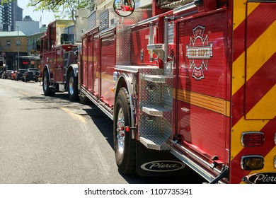 Seattle, WA, USA May 13, 2018: Seattle Fire Department truck navigates small city streets near Pike Market en route to an emergency call