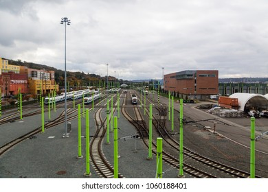 Seattle, WA USA Nov. 1, 2014: Sound Transit Link Light Rail train yard in SODO district of Seattle under typical cloudy skies with several light rail trains and green pylons