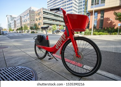 Seattle, WA, USA - Oct 11, 2019: JUMP dockless shared electric bike is seen parked on the sidewalk in South Lake Union neighborhood.