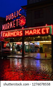 Seattle, WA, USA October 23, 2014 The neon signs of the Public Market in Seattle reflect on a typical rainy evening in the city
