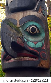 Seattle, WA, USA October 24, 2014 A large wooden totem pole dominates Pioneer Square in Seattle, Washington and honors the Pacific Northwest Native Americans who lived in the area.