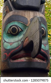 Seattle, WA, USA October 24, 2014 A bird figure emerges from a hand crafted totem pole in Pioneer Square, in Seattle, Washington