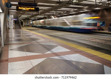Seattle, WA, USA Sept 4, 2017: Link Light Rail train blurred in long exposure as it leaves underground station and enters tunnel in Seattle Downtown Transit tunnel