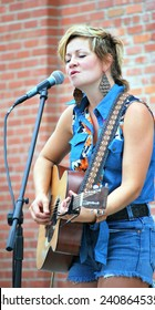 SEATTLE, WA__CIRCA JULY 9, 2014__Patti Fiasco folk, pop singer performing in concert. circa July 9, 2014 in Seattle, Wa.