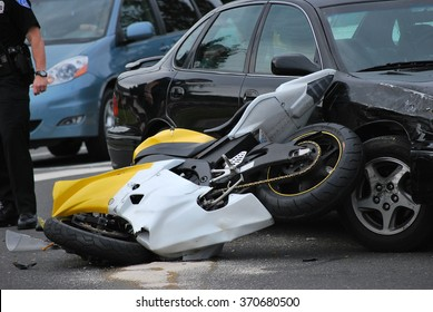 SEATTLE, WA__CIRCA__JUNE 12, 2008__Motorcycle and car accident on a highway,