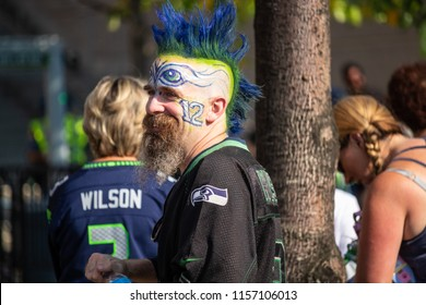 Seattle, Washington - 8/9/2018 : A fan with face paint and a mohawk before a Seattle Seahawks game.