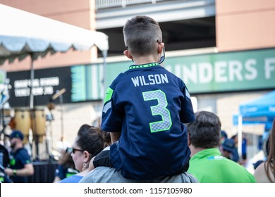 Seattle, Washington - 8/9/2018 : A young Seahawks fan wearing a Russel Wilson jersey waiting for a game to begin at Centurylink Field.