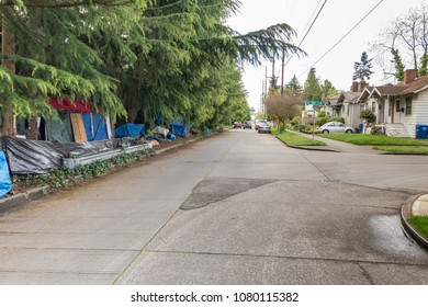 SEATTLE, WASHINGTON, APRIL 29, 2018: A homeless encampment in a Seattle neighborhood near Interstate 5 was forced to move after nearby homeowners complained that it had become a public nuisance.
