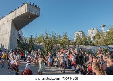 SEATTLE, WASHINGTON - Aug. 31,. 2017: Dancers from Pacific Northwest Ballet perform at Olympic Sculpture Park ,part of Seattle Art Museum Summer at Sam  outdoor sculptured dance program.  Space Needle