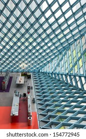 SEATTLE, WASHINGTON - AUGUST 3: Steel and glass walls and the lobby of the Seattle Central Library building on August 3, 2013 in Seattle, Washington