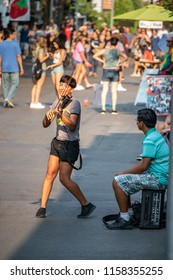 Seattle, Washington - August 9, 2018 : A street performer busking in Seattle near the Space Needle.