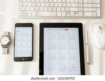 Seattle Washington circa December 2018 talet, smart phone and watch flat layer on desk with calendar apps open.