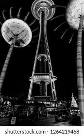 Seattle, Washington circa December 2018 Night view of the Space Needle landmark attraction sonic bloom sculpture.
