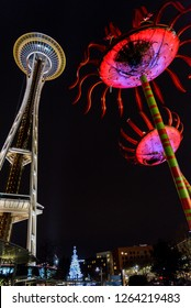 Seattle, Washington circa December 2018 Night view of the Space Needle landmark attraction with colorful Sonic Bloom sculpture.