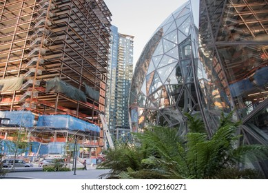 Seattle, Washington circa May 2018 Amazon companies world headquarters Spheres  campus afternoon with new construction office tower being built.