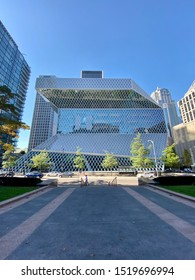 Seattle Washington circa October 2019, the downtown Seattle King County flagship library under midday blue sky.