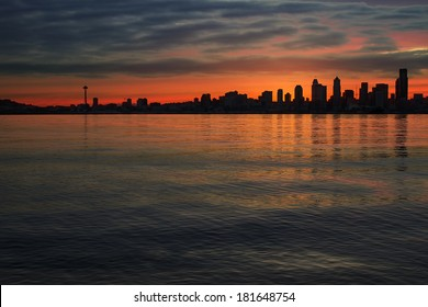 Seattle Washington City Skyline Silhouette at Early Morning Dawn Sunrise Along Puget Sound