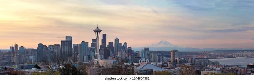Seattle Washington downtown skyline with Mount Rainier on a beautiful sunrise morning panorama