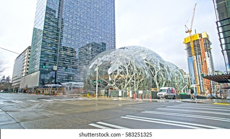 SEATTLE, WASHINGTON - FEBRUARY 6, 2017: Amazon's three giant glass biosphere domes are under construction in the Denny Triangle area of Downtown Seattle. Inside will be over 300 species.