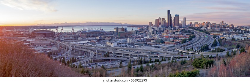SEATTLE, WASHINGTON - JAN 2016: South of City Downtown Stadiums, Bridges, Traffic, Cityscape Panorama View Sunset Colors