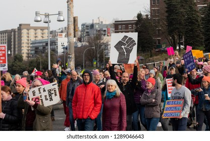Seattle, Washington January 19th 2019 the Women's March protest people and signs, resist fist in large group.