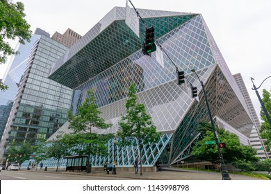 Seattle, Washington - July 1, 2018 : Exterior view of the Seattle Central Library, a landmark glass building designed by architects Rem Koolhaas and Joshua Prince-Ramus, located in downtown Seattle.