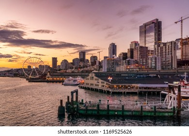 SEATTLE, WASHINGTON - JUNE 5, 2018: Seattle waterfront skyline at dusk with piers and skyscrapers from the Downtown District.