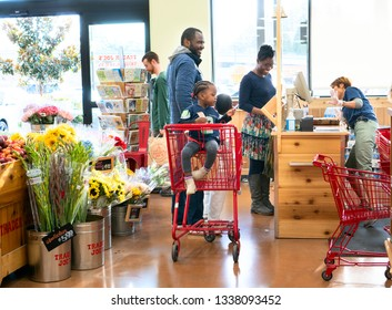 Seattle Washington, March 14 2019. African-American family is happily shopping at Trader Joe's, an American chain grocery store operating with a concept of fresh format.
