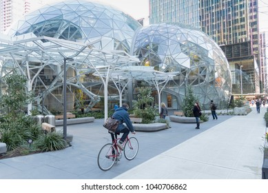 Seattle, Washington March 2020: The Amazon company campus in South Lake Union Cascadia neighborhood, people on campus grounds with Spheres.