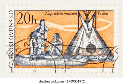 SEATTLE WASHINGTON - May 2, 2020:  Czechoslovakia stamp with Native Americans, canoe and tepee of the National Naprstek Museum of Prague. Scott # 1400