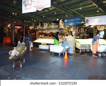 Seattle, Washington - May 27, 2018: The iconic bronze pig at Pike Place Market, a famous public market in Seattle.
