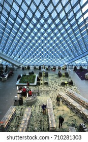 Seattle, Washington - May 30, 2017: Readers look up books and have rest in the main hall of Seattle Public Library.