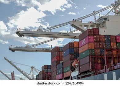 SEATTLE / WASHINGTON - November 28, 2018 : Container ship and dockyard cranes, Seattle waterfront Puget Sound, Pacific Northwest