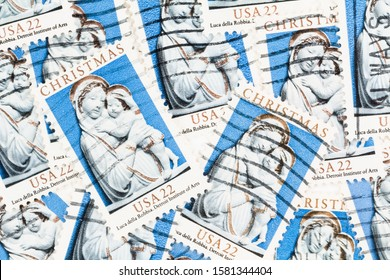 SEATTLE WASHINGTON - November 28, 2019:  Christmas stamps background of of Madonna and Child with blurred postage background.  Scott # 2165.