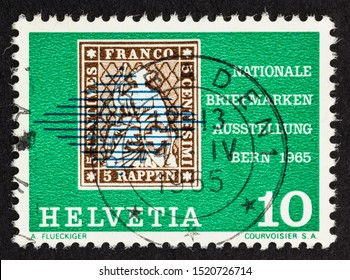 SEATTLE, WASHINGTON - October 2, 2019: Close up of green Swiss Stamp featuring an historic 5 rappen stamp on a 10 centime stamp issued in 1965.
