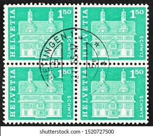 SEATTLE, WASHINGTON - October 2, 2019: Close up of  postage stamp from Switzerland featuring historic Reding House. Scott # 398.  Block of four green postage stamps.
