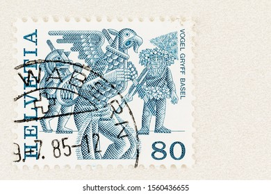 SEATTLE WASHINGTON - October 4, 2019: Folklore of Switzerland on postage stamp issued in 1977, featuring Griffin in blue on 80 centimes stamp. Scott # 643.