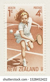 SEATTLE WASHINGTON - October 5, 2019: New Zealand surcharged Health stamp issued in 1972 featuring a girl playing tennis. Scott # B86.