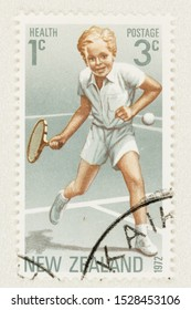 SEATTLE WASHINGTON - October 5, 2019: New Zealand surcharged Health stamp issued in 1972 featuring a girl playing tennis. Scott # B85.